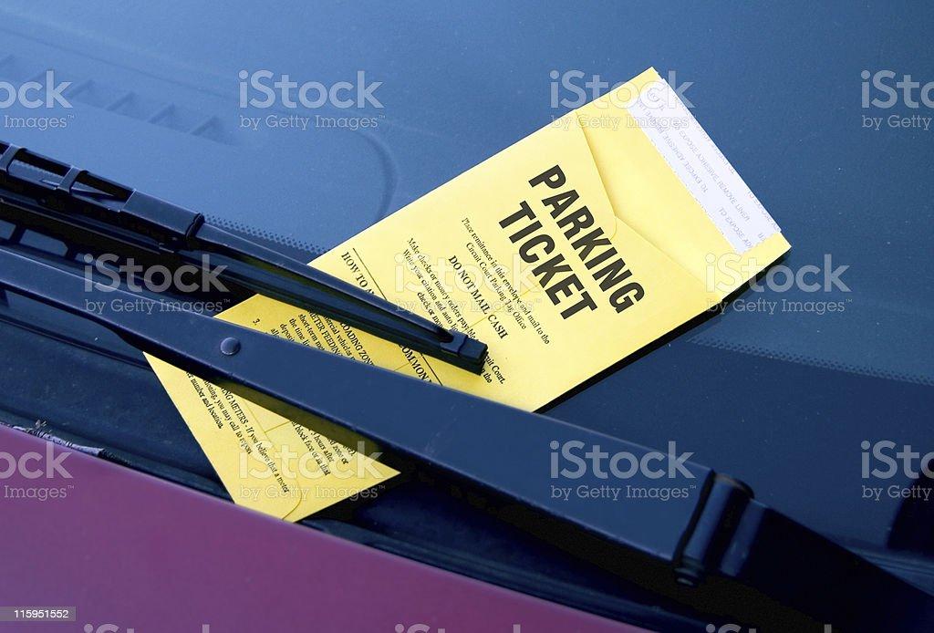 Parking violation underneath wiper blade stock photo