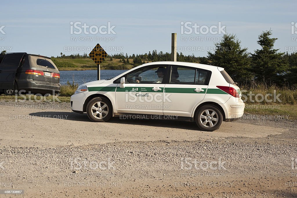 Parks Canada Officer in Marked Car stock photo