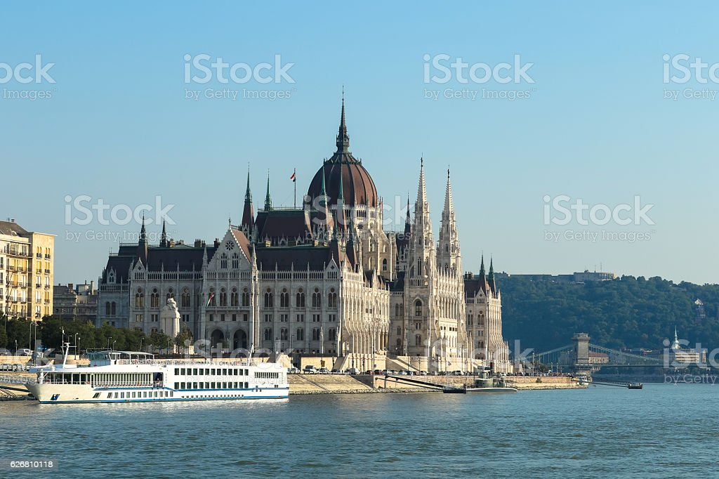 Parliament building, cruise ship on the Danube river bank, Budapest stock photo