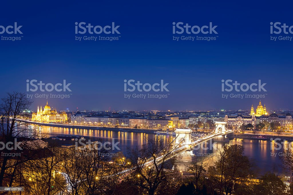Parliament Chain Bridge and Basilica in Budapest at dusk stock photo