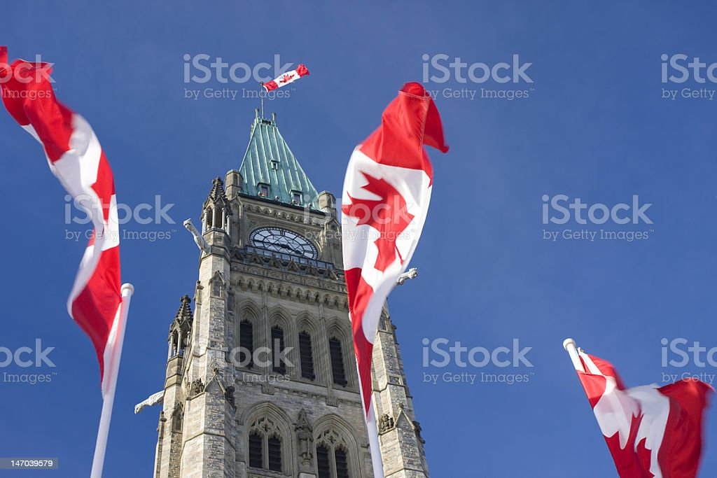 Parliament of Canada, Peace Tower, Canadian Flags stock photo
