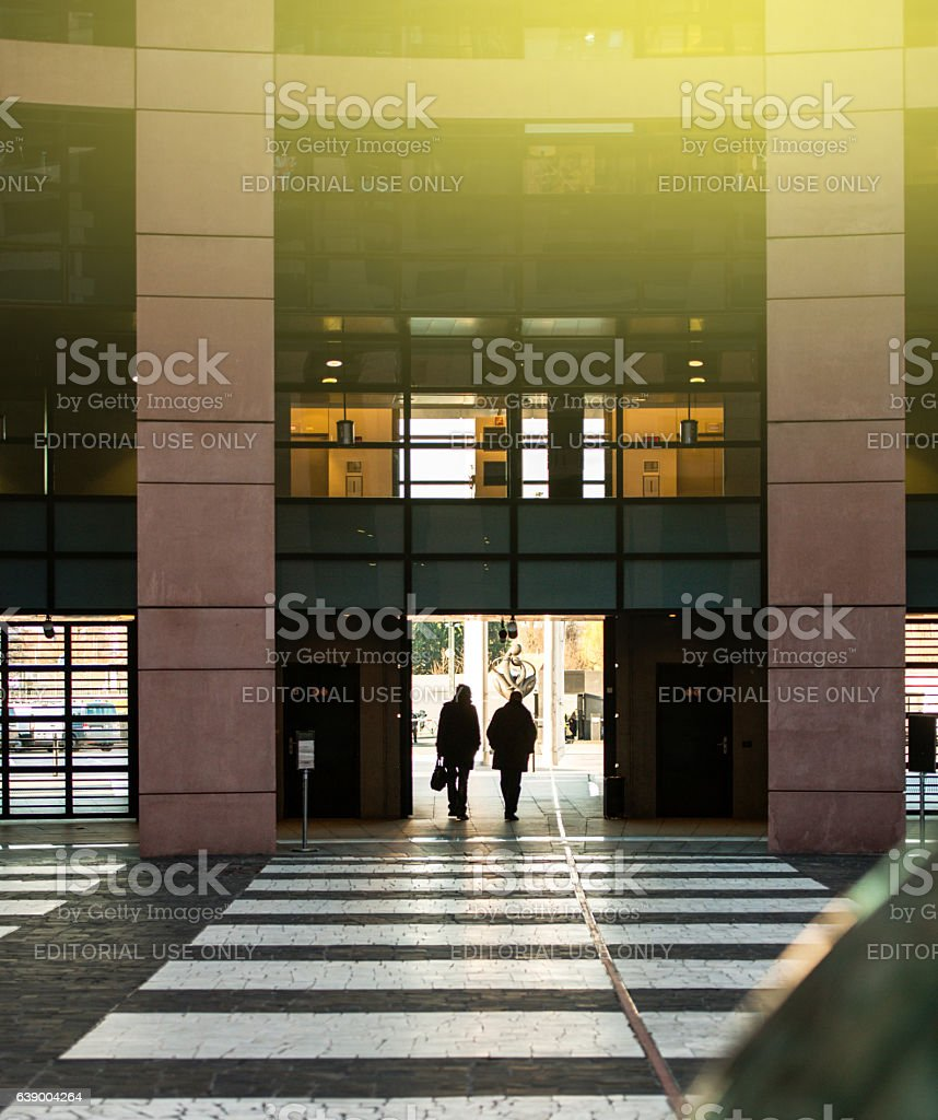 Parliamentarians exiting European Parliament building stock photo