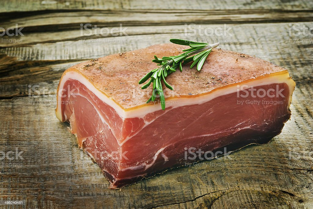 parma ham on a wooden board stock photo
