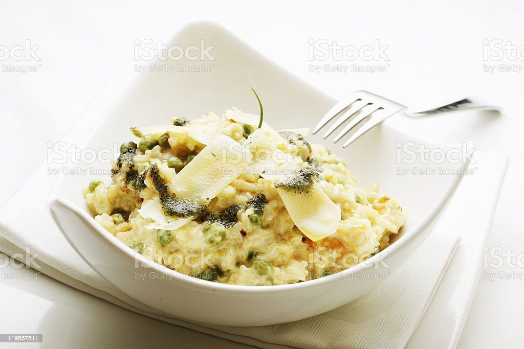 Parmesan and Vegetable Risotto in Bowl with Fork royalty-free stock photo