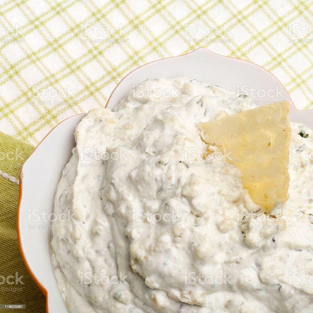Parmesan Artichoke Dip with a Potato Chip Garn stock photo