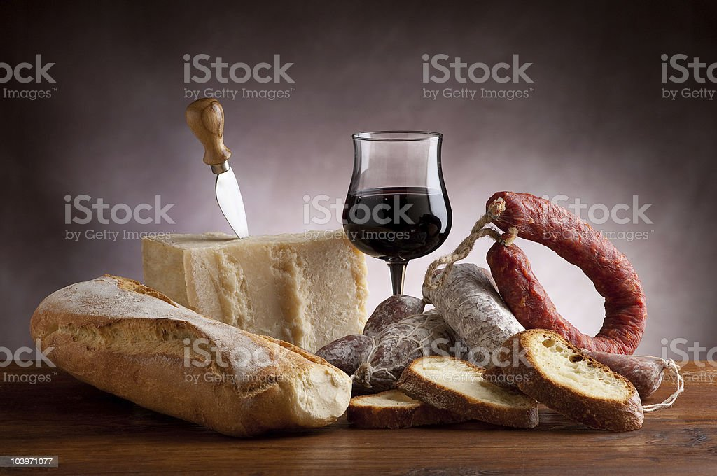 parmesan cheese and salami with red wine stock photo