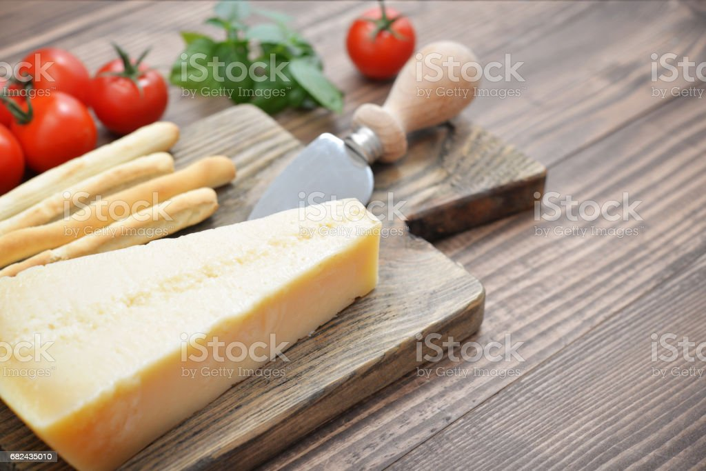 Parmesan cheese on cutting board stock photo