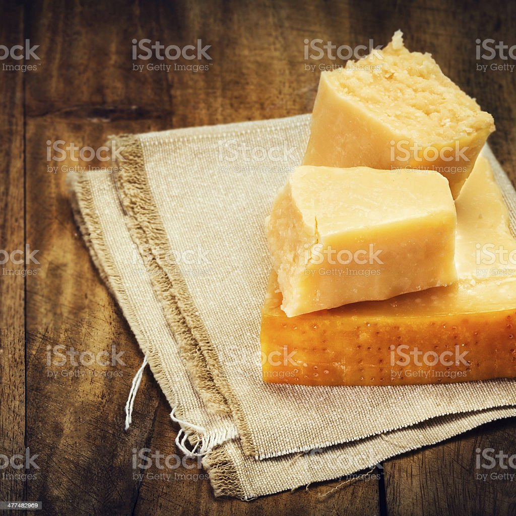 Parmesan Cheese on Wooden Background close up. stock photo