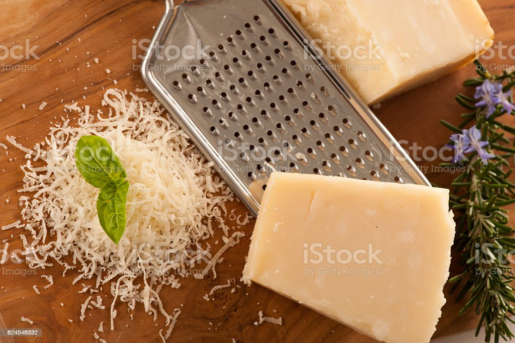 Parmesan cheese on wooden  plate stock photo