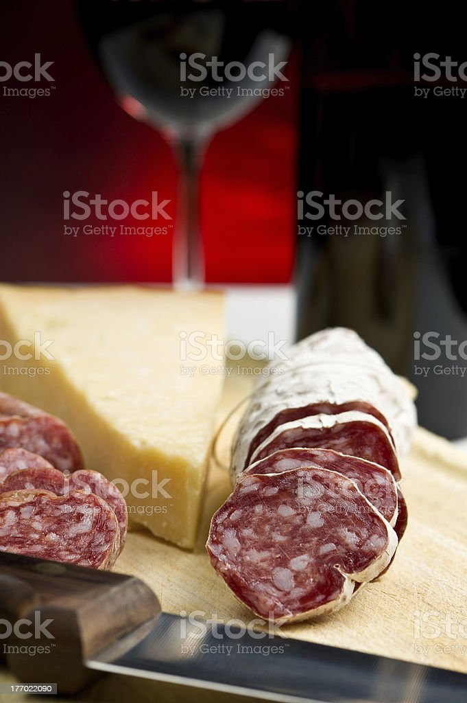 Parmesan cheese, salame and red wine royalty-free stock photo