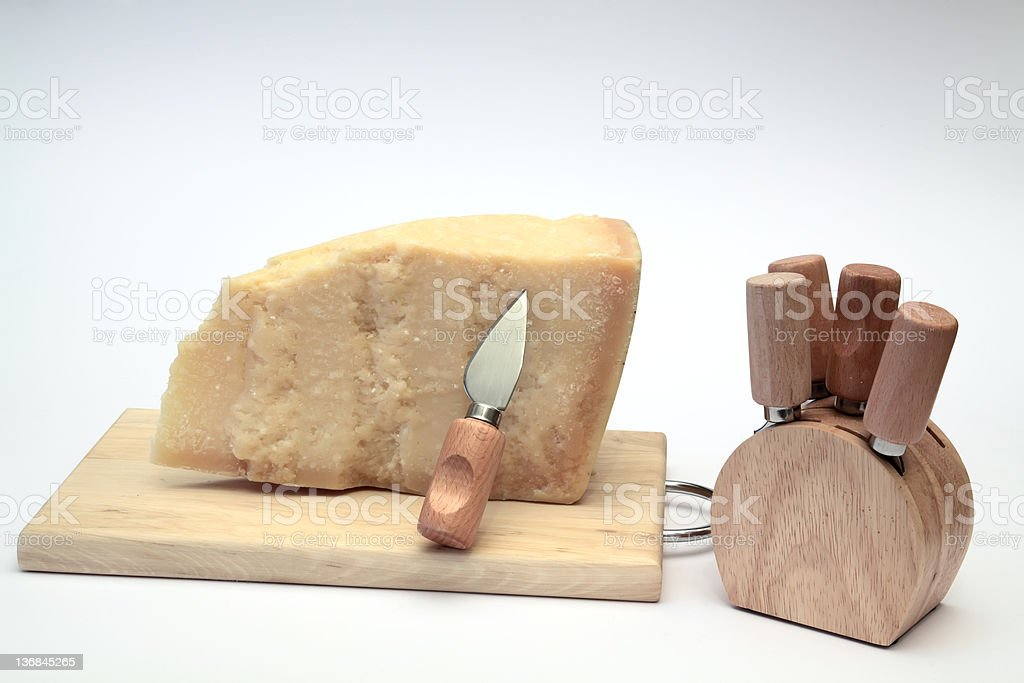 Parmesan cheese slice with set of  knives royalty-free stock photo