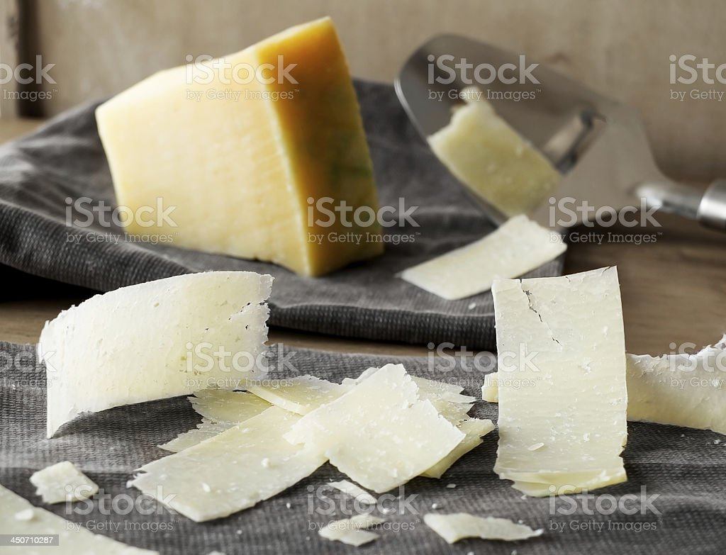 Parmesan cheese slices. stock photo