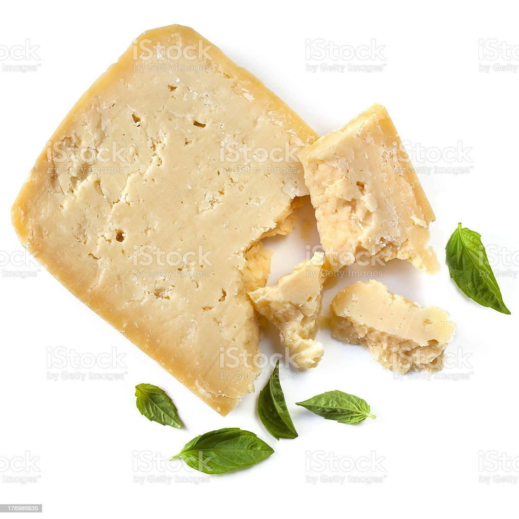 Parmesan Cheese with Basil Leaves Isolated stock photo