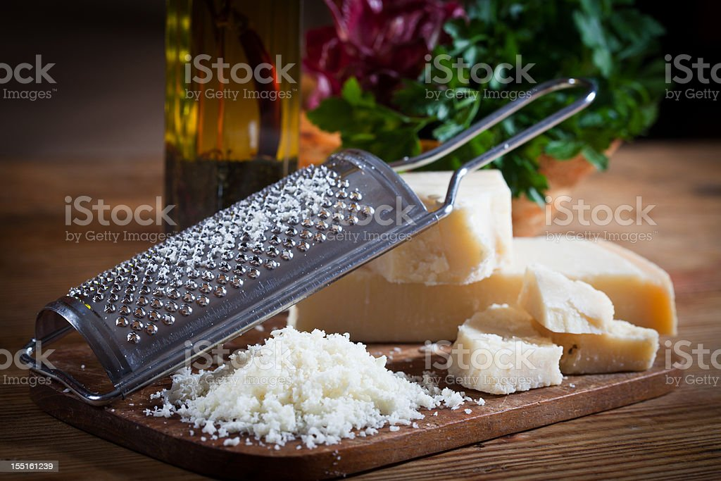 Parmesan cheese with grater stock photo