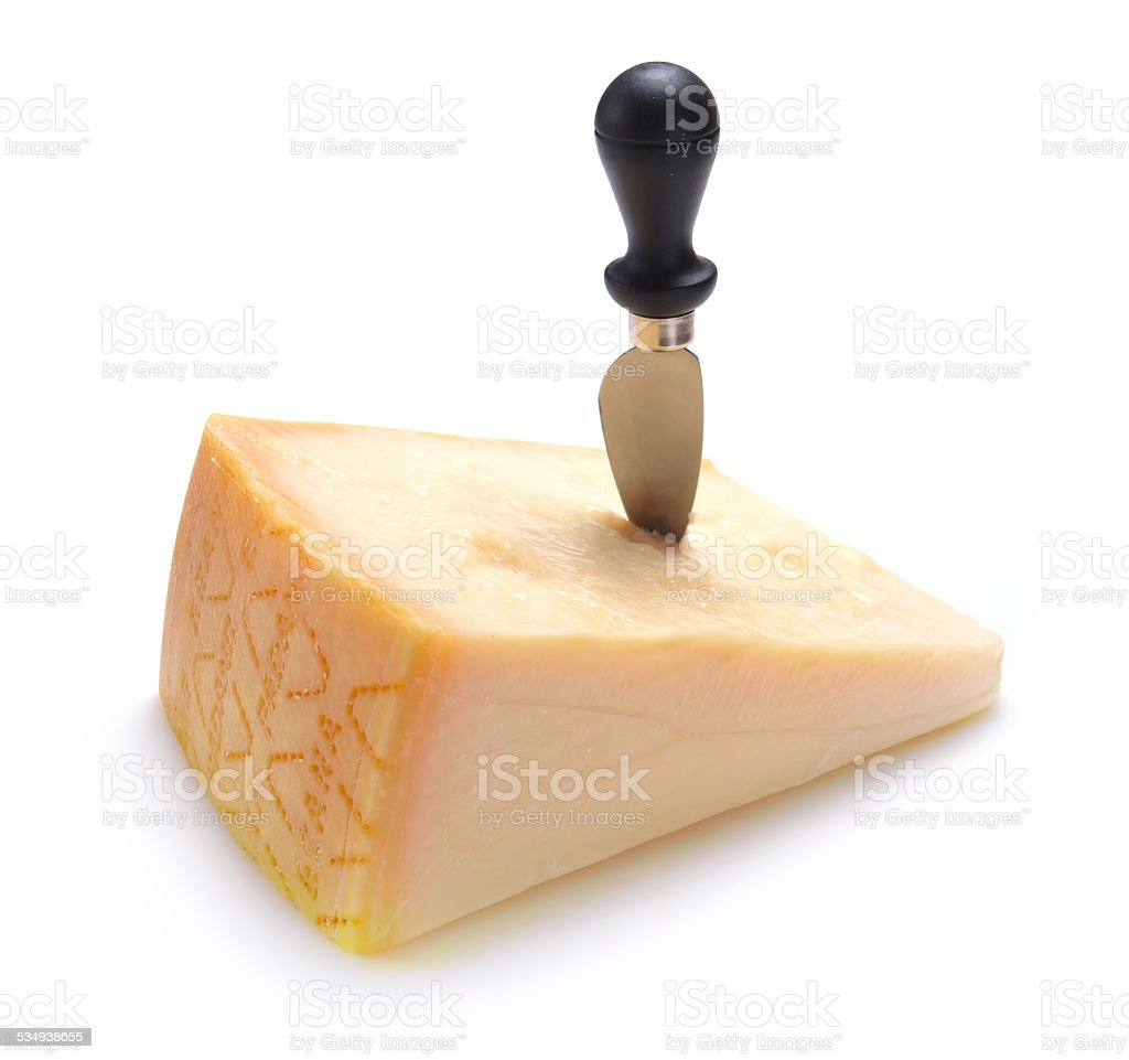 Parmesan cheese with knife stock photo