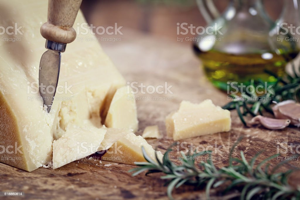 Parmesan Cheese with rosemary and olive oil stock photo
