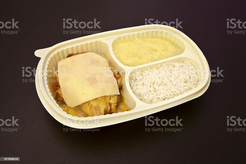 Parmesan chicken fillet, rice and mashed potatoes stock photo