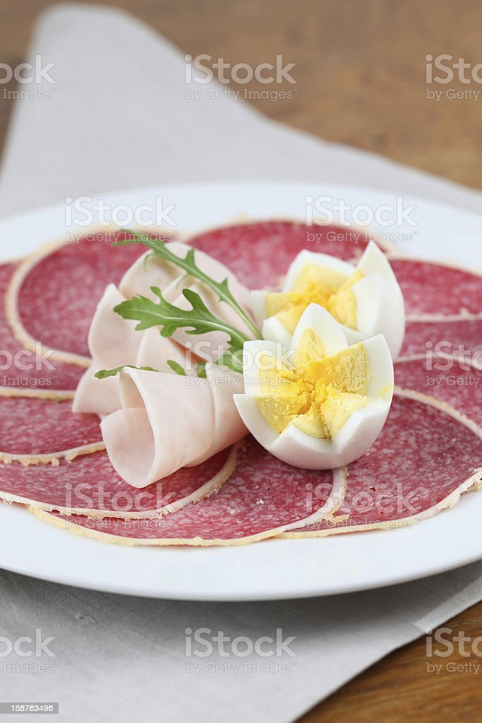 Parmesan crust salami with ham and eggs royalty-free stock photo