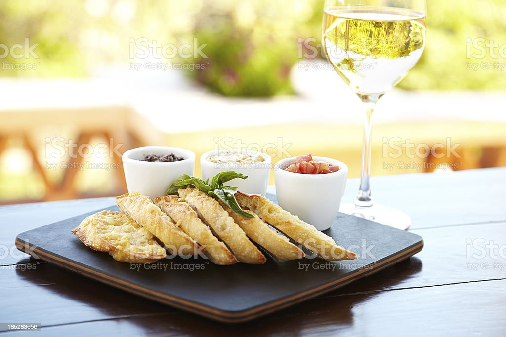 Parmesan crusted bread with three different dips royalty-free stock photo