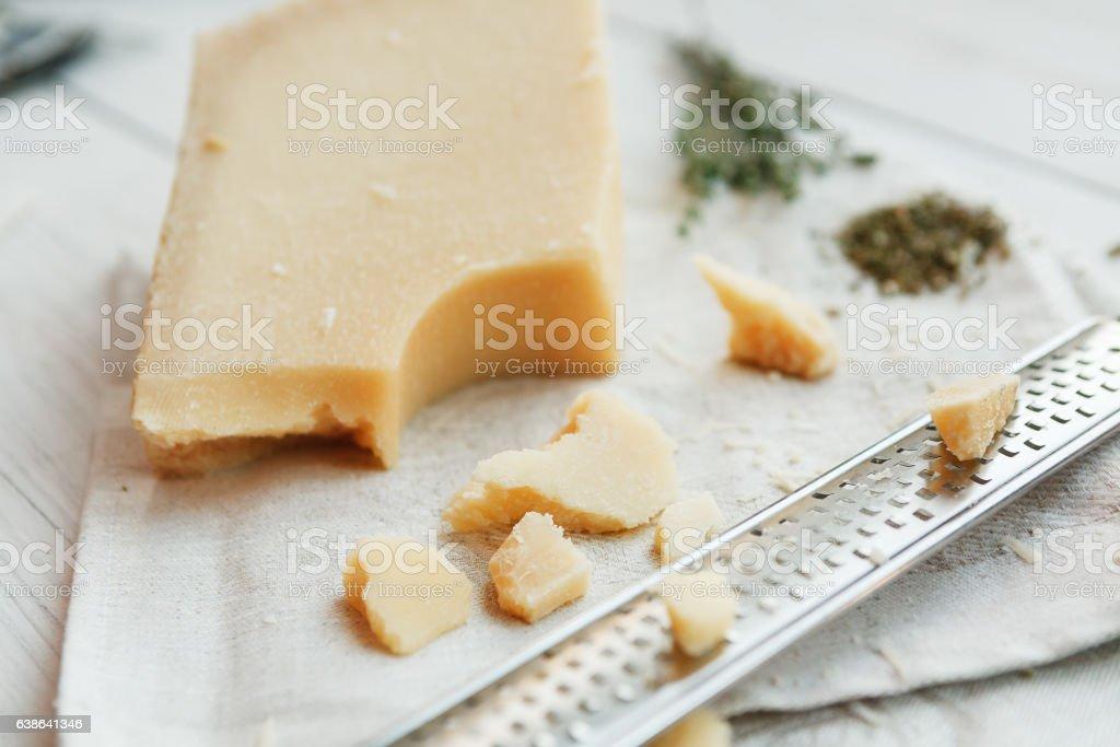 Parmesan piece closeup with small grater stock photo