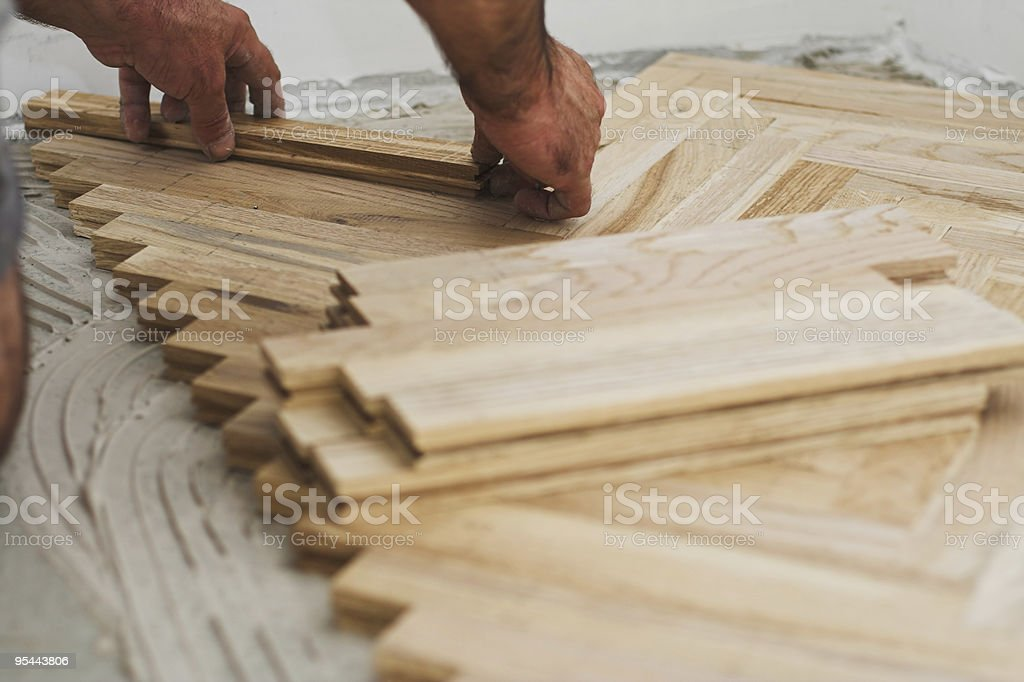 Parquet and carpenter concept royalty-free stock photo