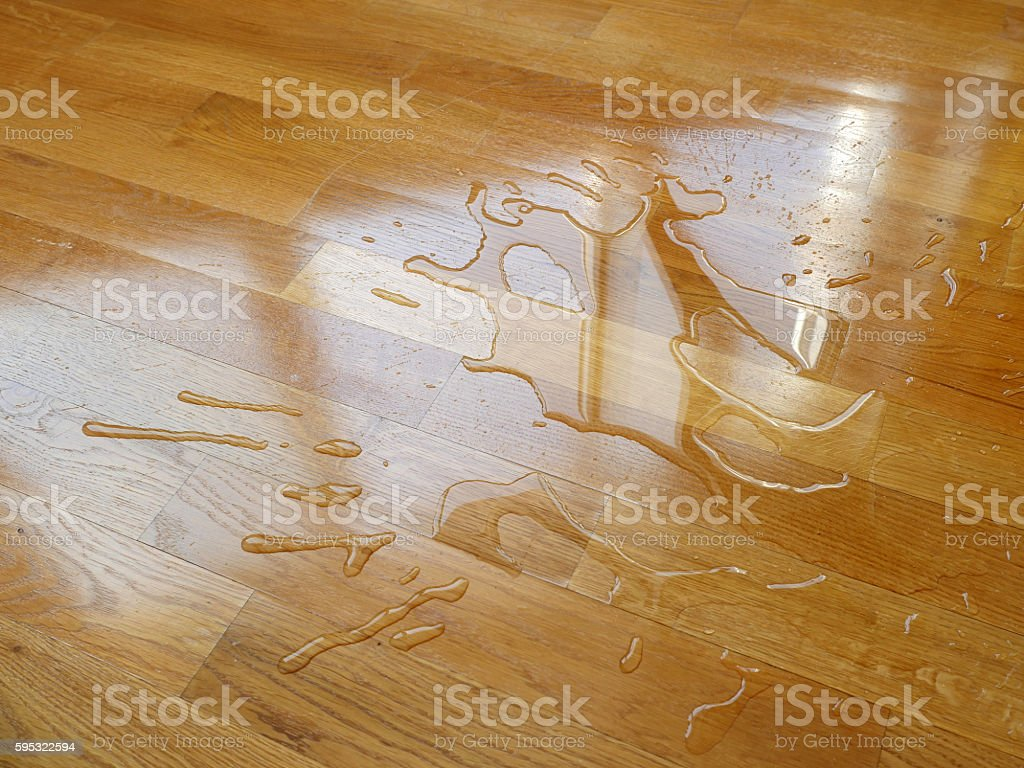 Parquet. Water drops on wooden surface. stock photo