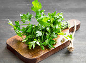 Parsley Culinary Herb on a Cutting Wooden Board