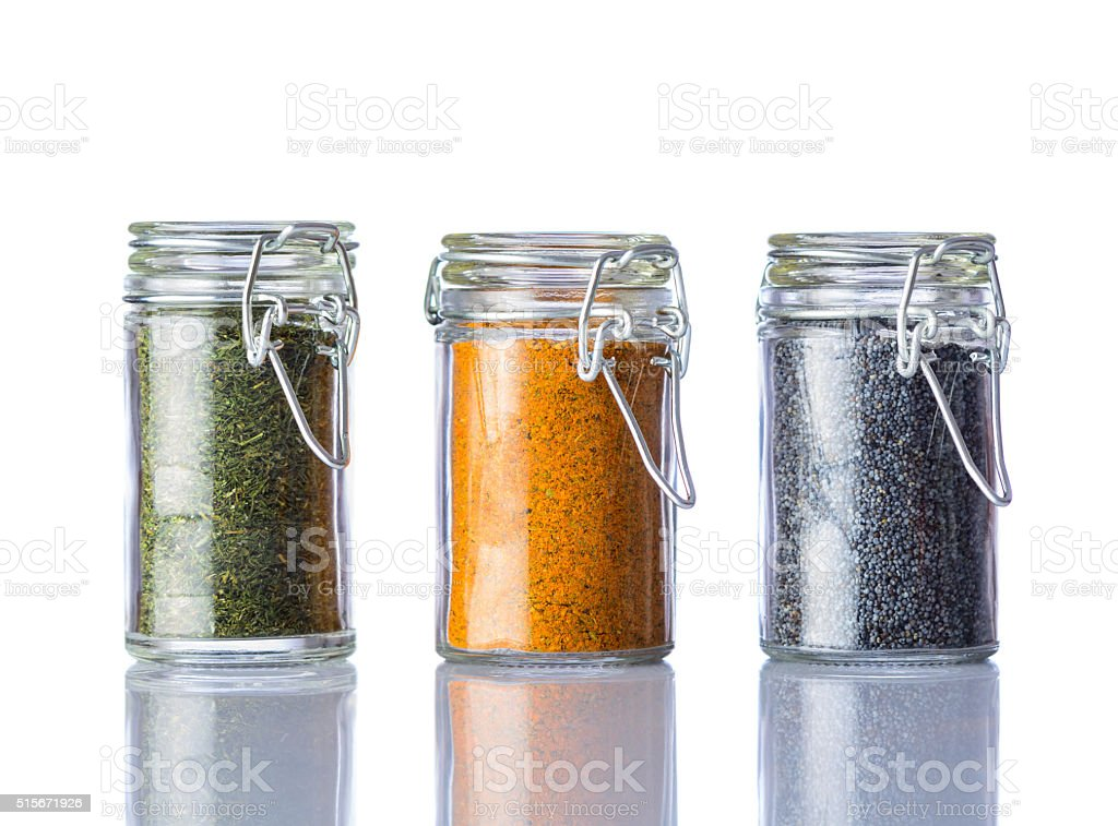 Parsley, Curry Powder and Poppy Seeds on White Background stock photo