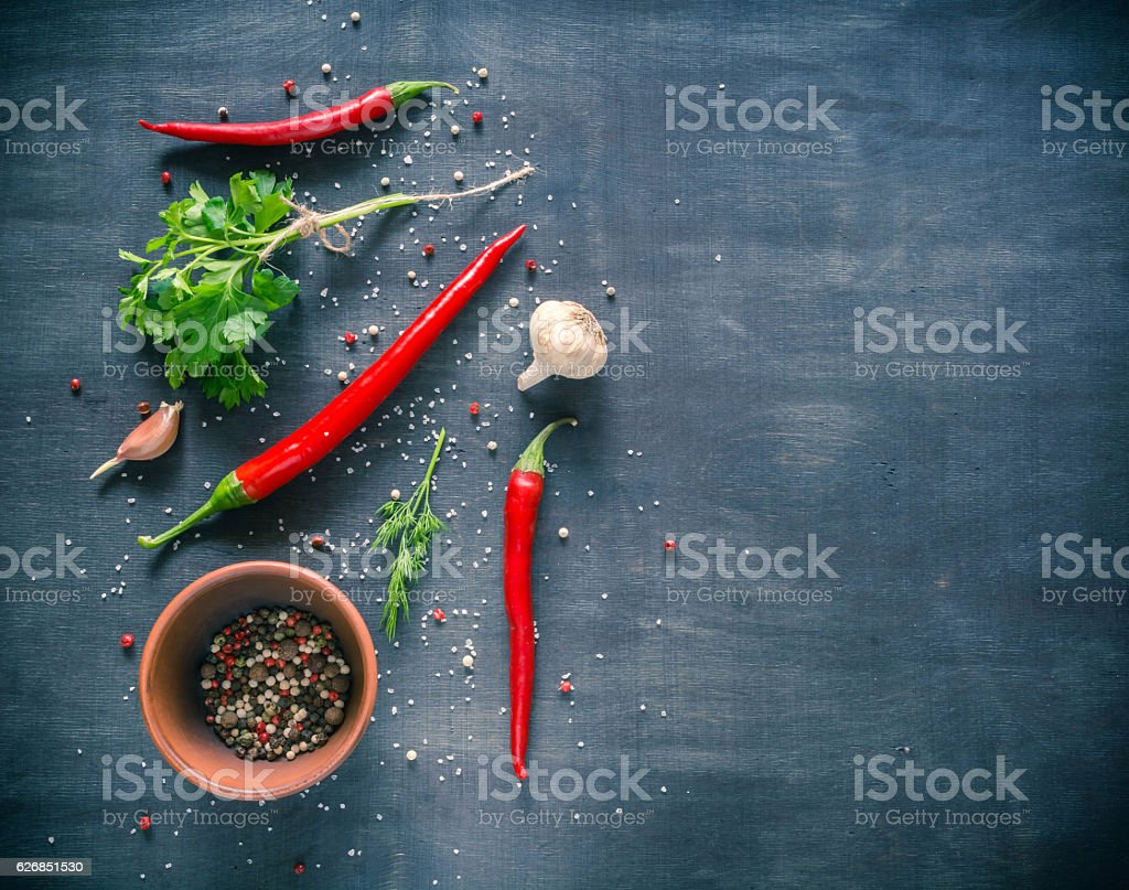 Parsley dill pepper and garlic in a dark wooden table stock photo