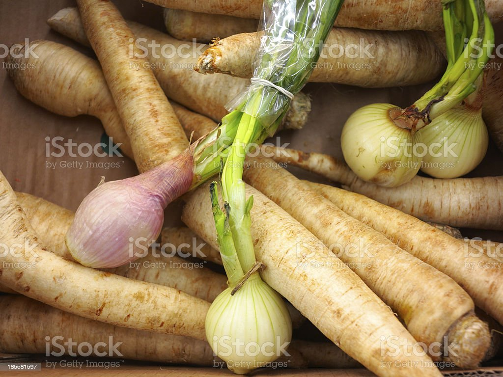 parsley root and onion in market royalty-free stock photo