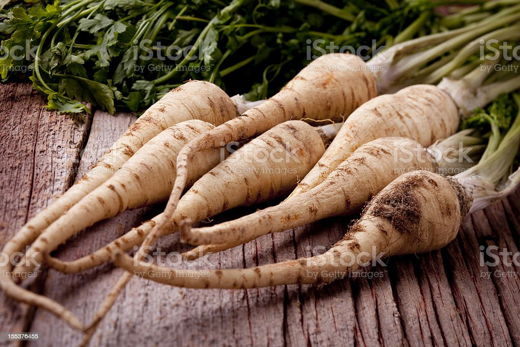 parsley root with greens stock photo