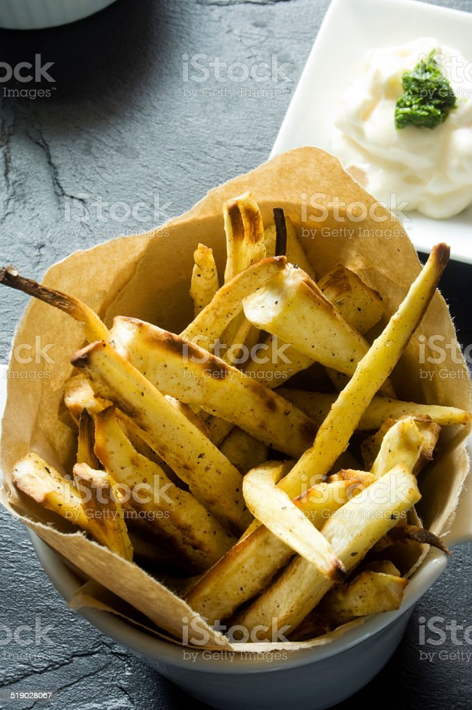 Parsnip Fries Served in Paper Lined Bowl and Mayonnaise stock photo