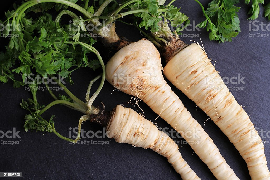 Parsnip on black background. Cooking, Healthy eating concept. stock photo