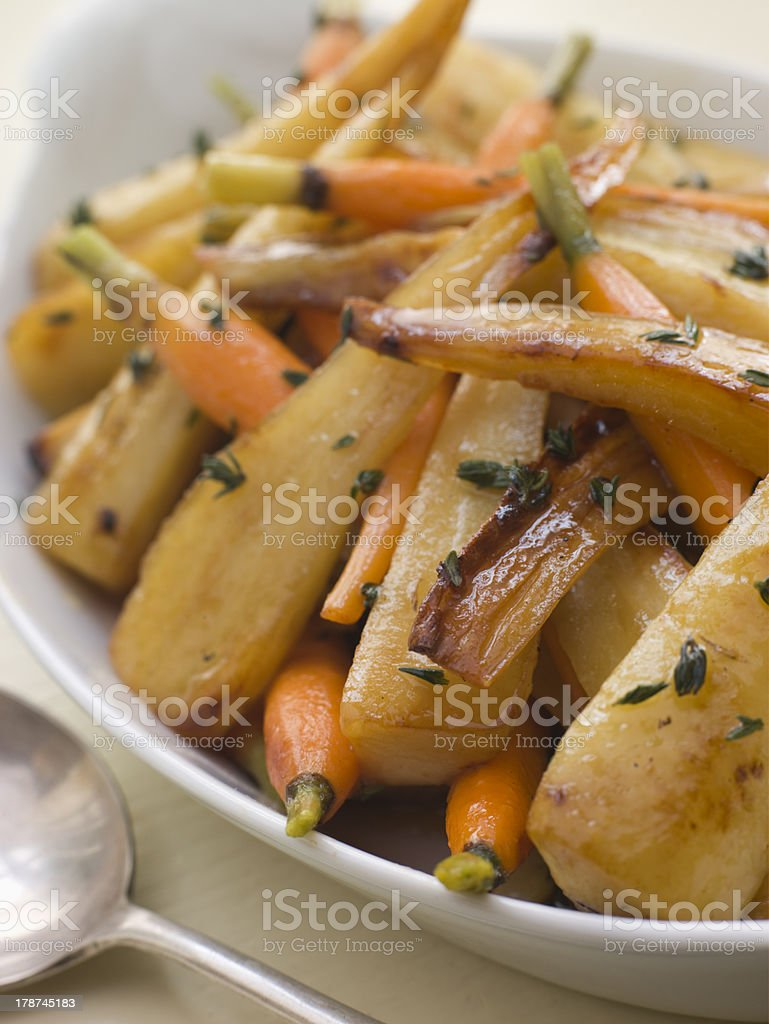 Parsnips and Baby Carrots Roasted in Thyme stock photo