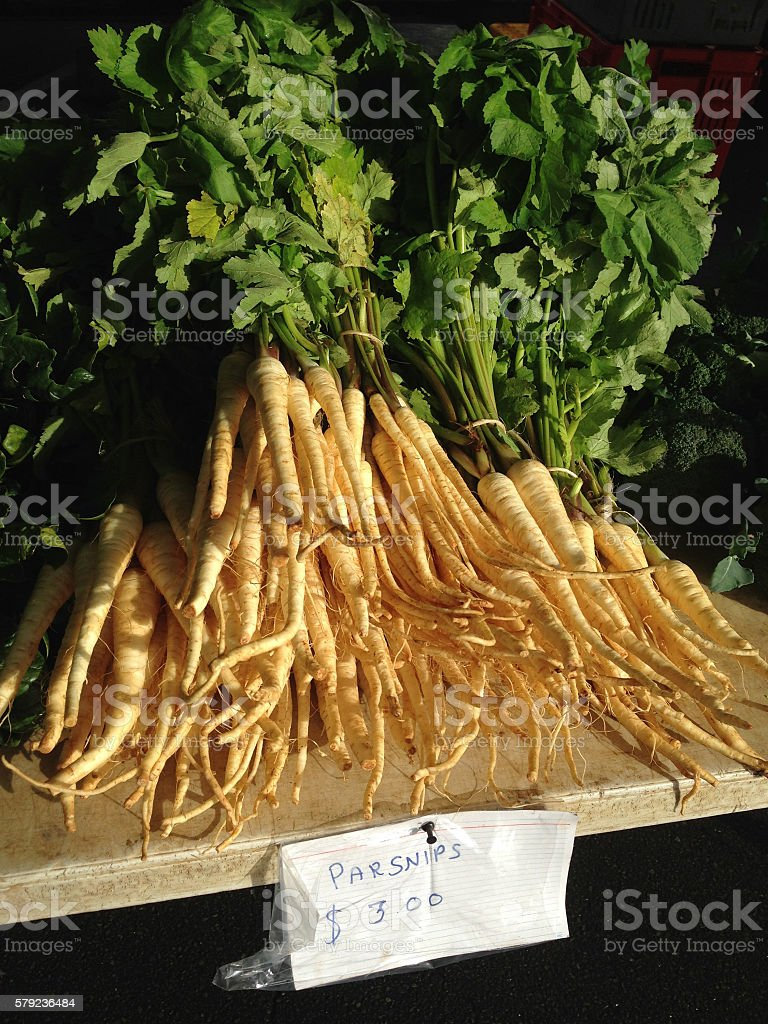 Parsnips at a farmers market stock photo