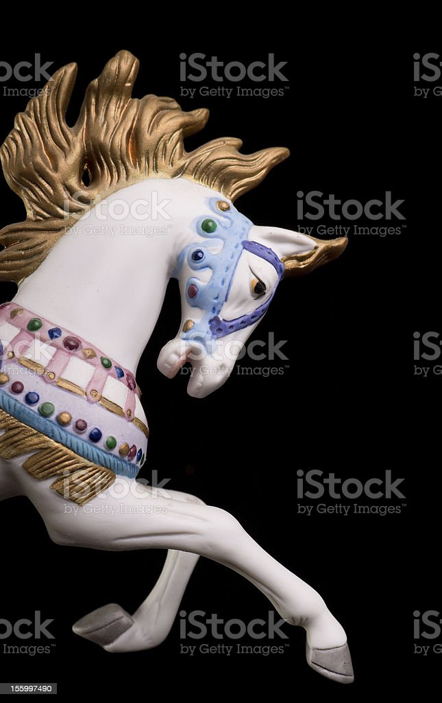 Part of a colorful carousel horse over a black background stock photo
