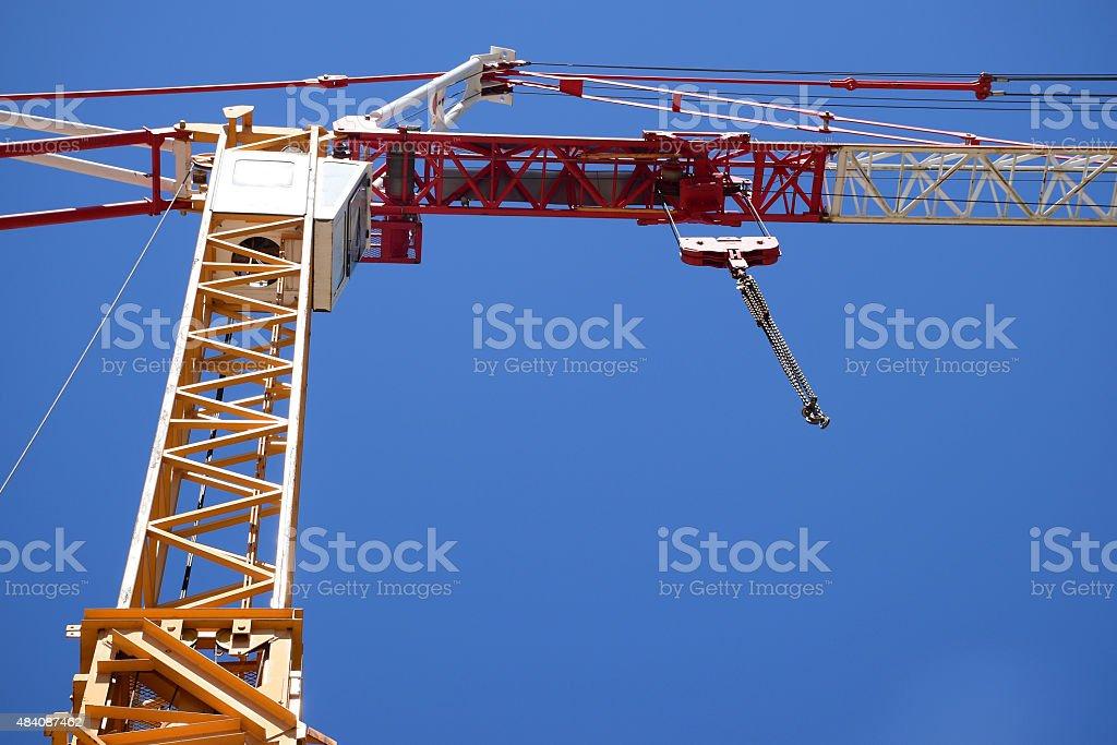Part of a construction crane against the blue sky stock photo