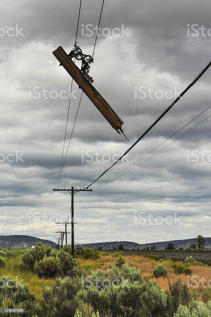 Part of a telephone pole hangs broken royalty-free stock photo