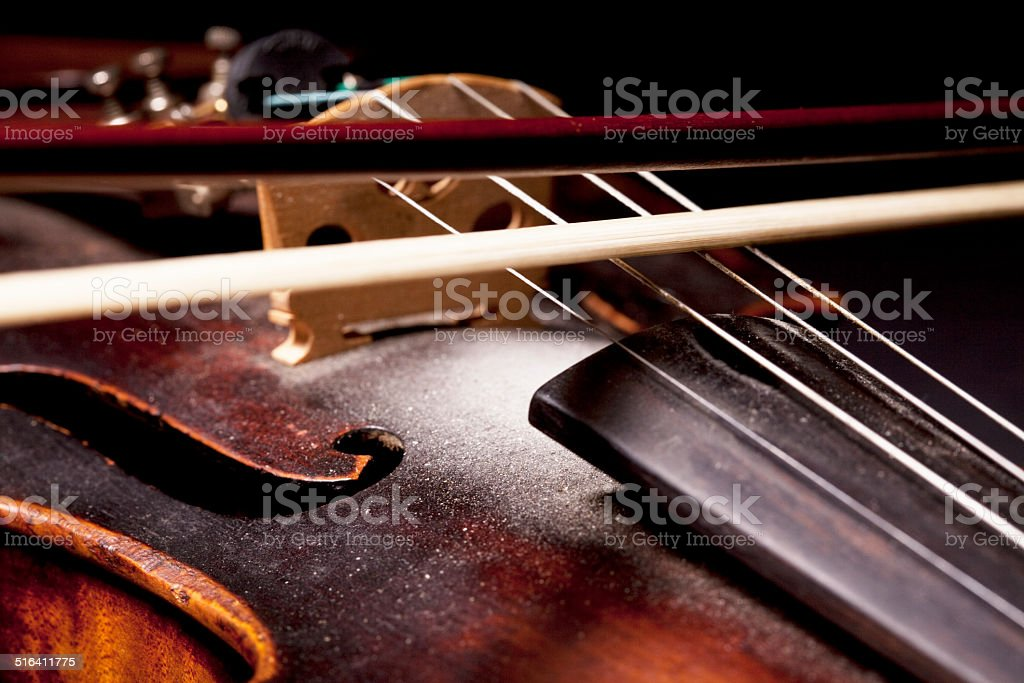 Part of a violin isolated on black background stock photo
