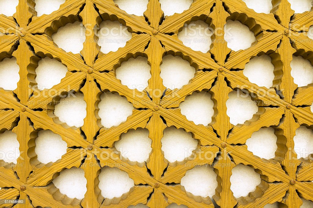 Part of a yellow painted shutter stock photo
