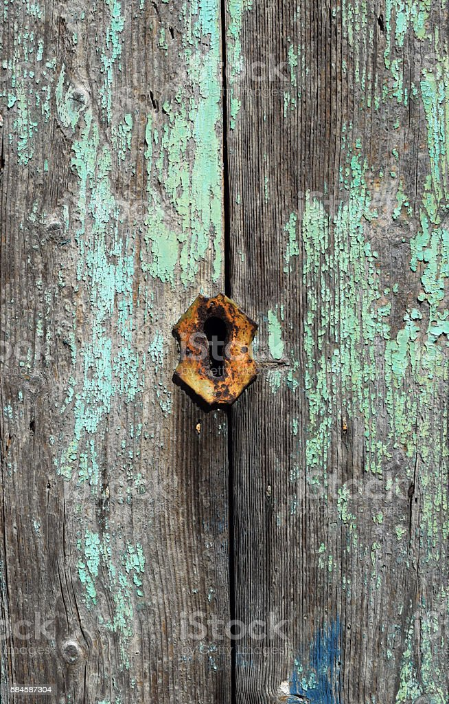 Part of an old door with a lock stock photo