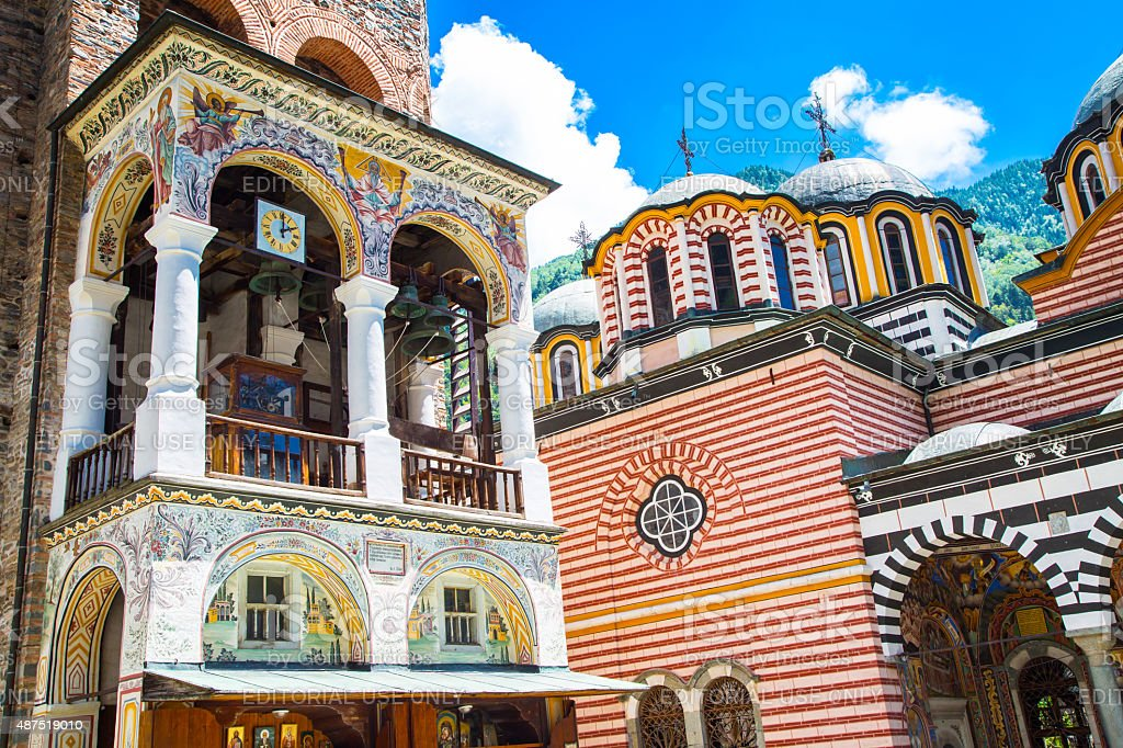 Part of bell tower and church in famous Rila Monastery stock photo
