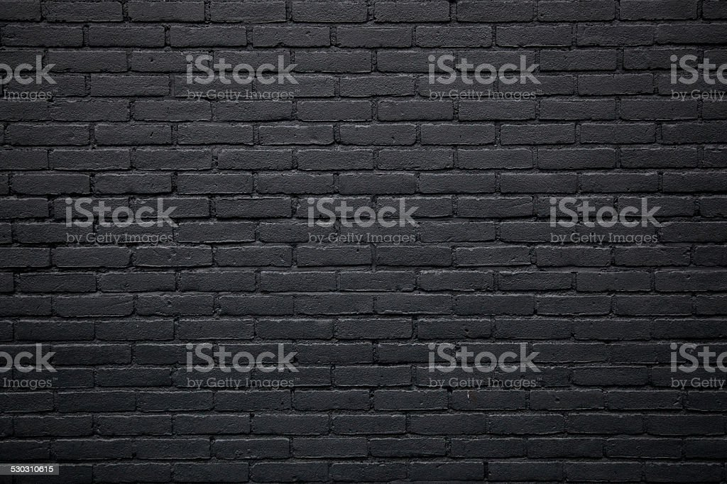 part of black painted brick wall stock photo