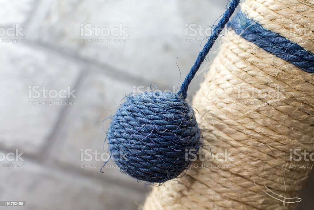 Part of Cat scratching post with the ball stock photo