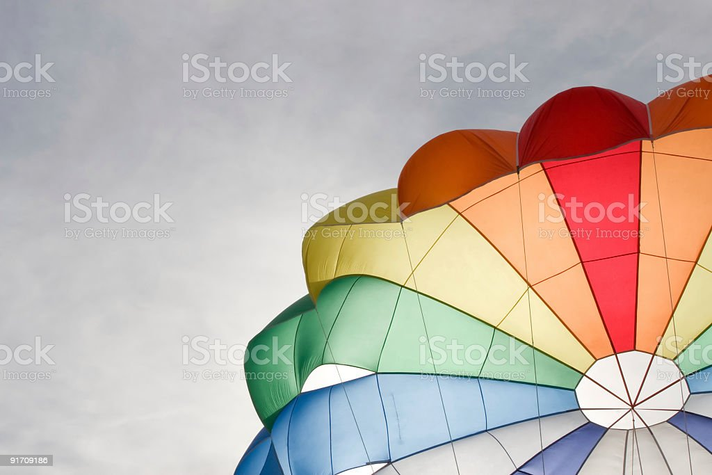 part of colour parachute on sky background stock photo