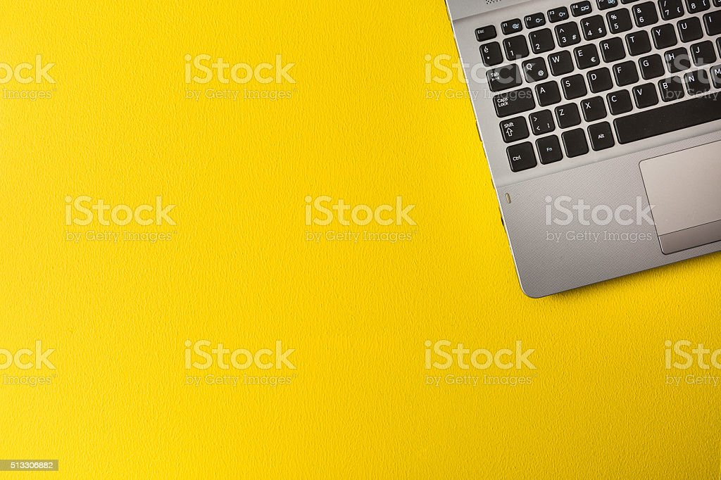 Part of Computer on yellow background stock photo