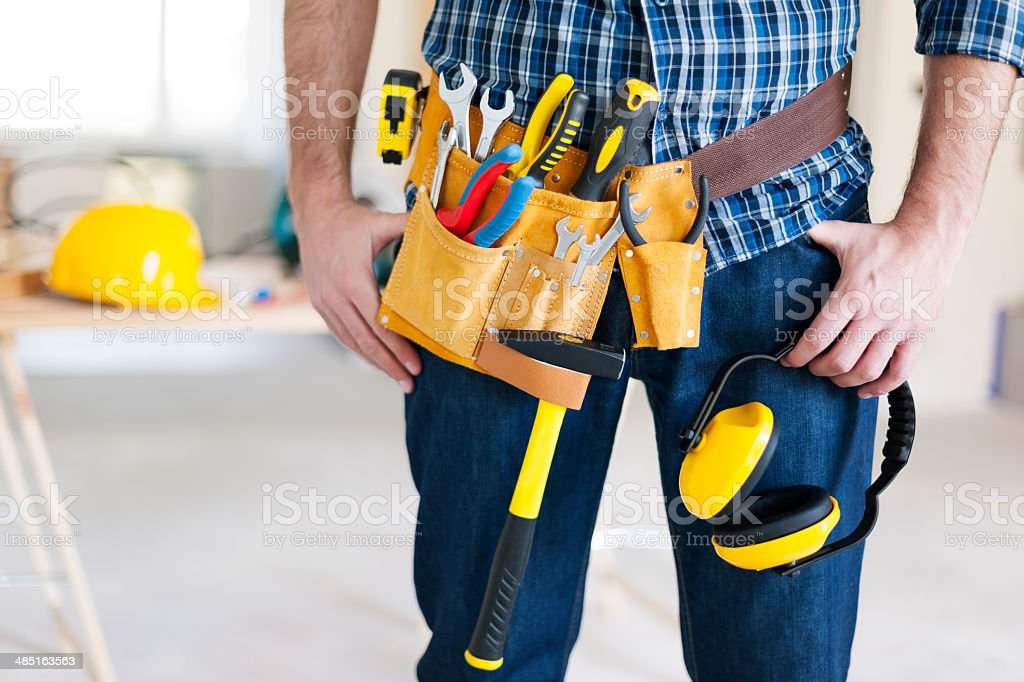 Part of construction worker with tools belt stock photo