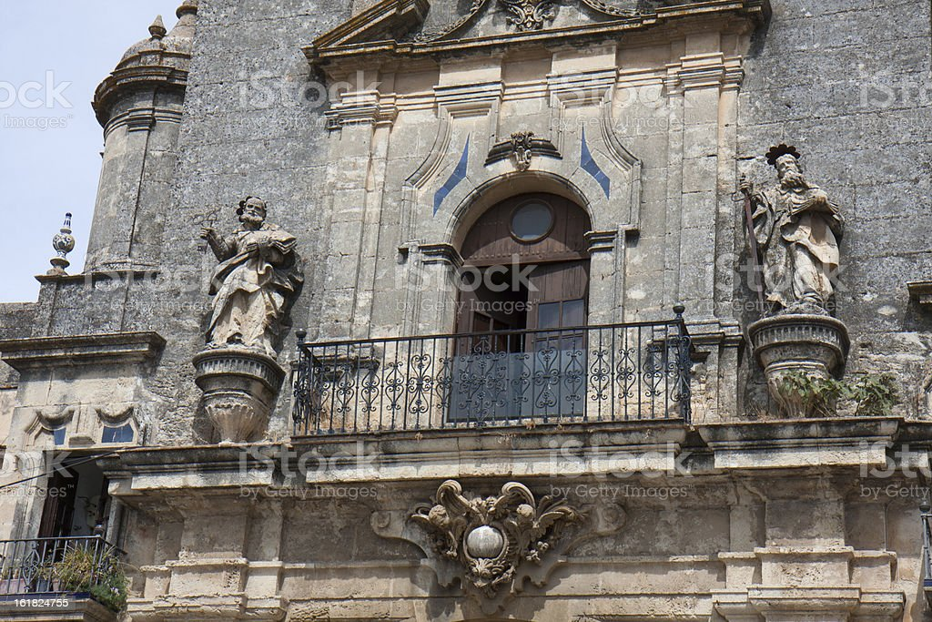 Part of facade with some statues. stock photo
