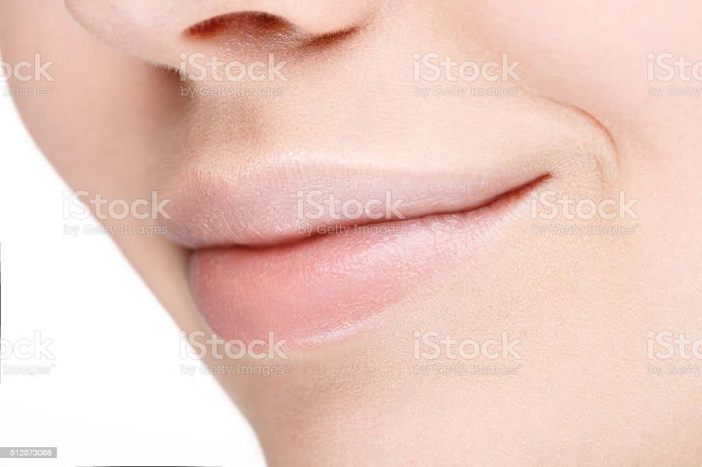 Part of face with beautiful full lips without makeup. stock photo