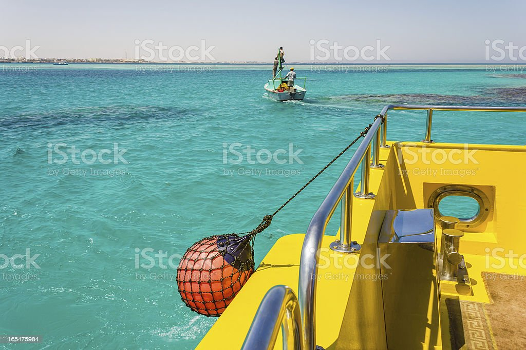 Part of fishing boat with red buoy royalty-free stock photo